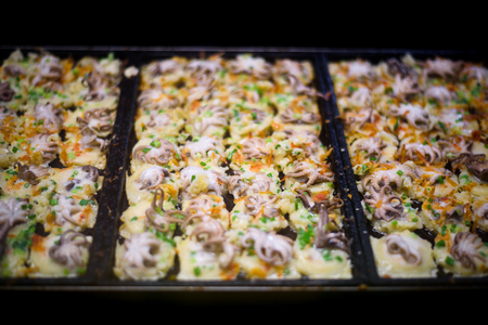 Close up hand process to cooking takoyaki most popular delicious snack of japan Stock Photo