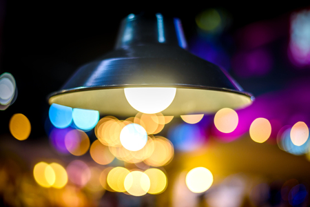 Lighting lamp Bulb with colorful bokeh background Stock Photo