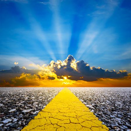 along the Road with Sunset Sky and sun rays background