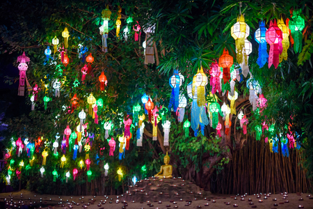 Beautiful Golden Buddha Statue at Wat Pan Tao Temple with colorful lanterns hanging on the tree , Chiang mai , Thailand Standard-Bild - 120714800