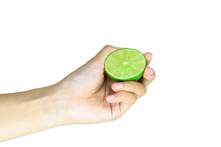 Female Hand Squeezing slice half Lime isolated on white background