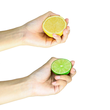 Two Hand Squeezing slice half Lime and Lemon isolated on white background 版權商用圖片