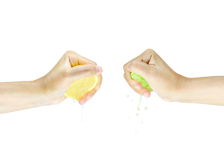 Two Hand Squeezing slice half Lime and Lemon isolated on white background Standard-Bild - 120714820