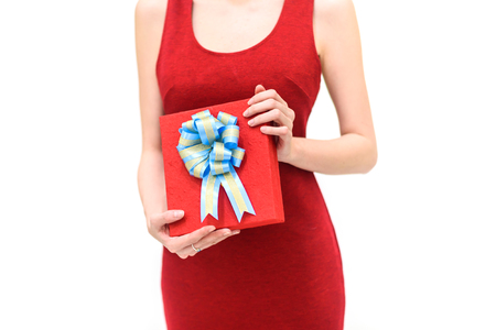 happy woman in red dress  holding gift box Isolated on white background. 版權商用圖片