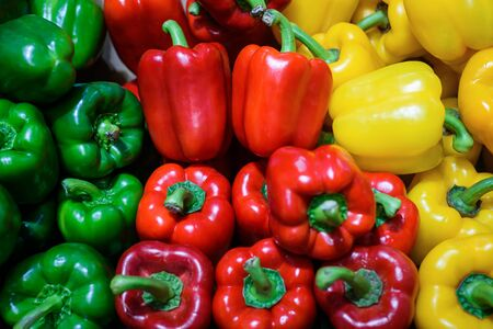 Fresh red green and yellow sweet bell peppers sale in market Reklamní fotografie