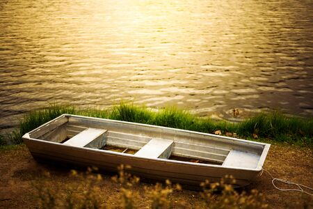 Boat on a Lake Coast in sunset