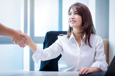 happy smiling successful business asian woman handshake with Business partnership client in modern office room