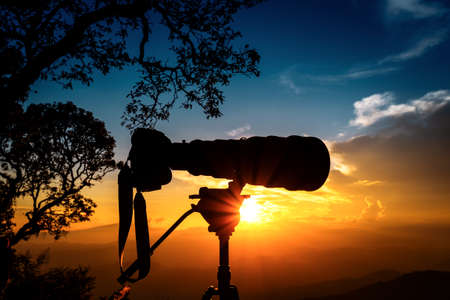 Silhouette of  telephoto lens at top of mountains during the sunset with two tone sunset sky Stok Fotoğraf