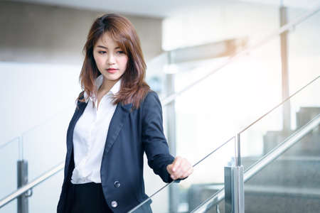 Beautiful asian business woman in modern office
