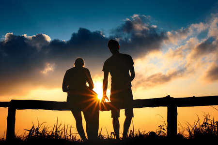silhouette Couple lover with mountains landscape in beautiful sunset sky Stock fotó