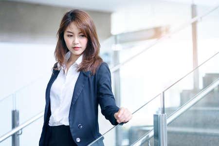 Beautiful asian business woman in modern office