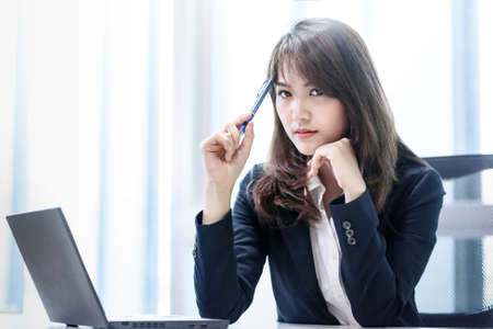 Stressed business working beautiful asian woman thinking with laptop in modern office room