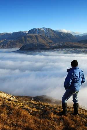 scotland landscape: Climber viewing Ben Nevis. Stock Photo
