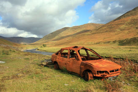burnt out: Burnt out old anandoned car in a highland glen.