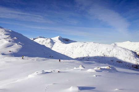 hillwalking: Winter climbers in Glencoe in the Scottish Highlands.