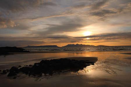 rhum: Sunset over the Isle of Eigg   Stock Photo