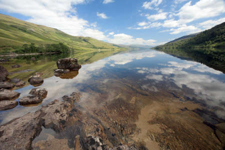 loch: Reflections on Loch Arkaig in the Scottish Highlands   Stock Photo