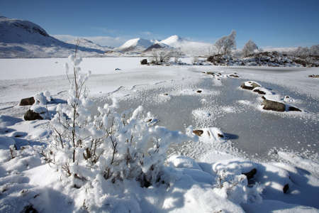 black moor: A frozen Lochan Na h Achlaise on Rannoch Moor in the Scottish Highlands