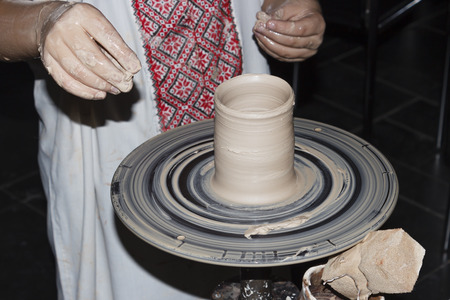 potters wheel: child makes pottery on potters wheel