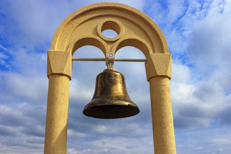 Sea bell against the blue sky with white clouds