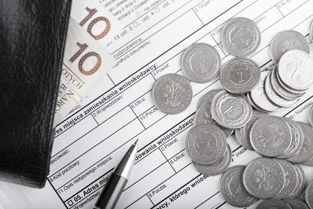 Business documents, wallet with polish paper money, one zloty coins and pen. Money and savings concept. photo