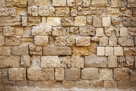 Traditional greek wall made of yellow rocks. Sides of Rhodes. Stock Photo