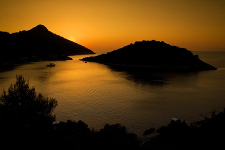 A beautiful sunset on Zaklopatica bay  Lastovo island in Croatia during summer  photo