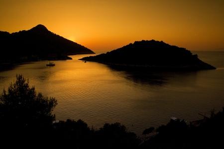 A beautiful sunset on Zaklopatica bay  Lastovo island in Croatia during summer Stock Photo - 12738757