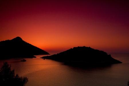 A beautiful sunset on Zaklopatica bay  Lastovo island in Croatia during summer  photo