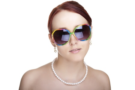 Beautiful young woman wearing sunglasses isolated on white background  Glamour portrait  Stock Photo - 12738782