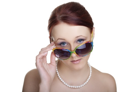 Beautiful young woman wearing sunglasses isolated on white background  Glamour portrait  Stock Photo - 12738761