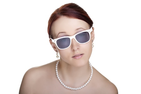 Beautiful young woman wearing sunglasses isolated on white background  Glamour portrait  photo