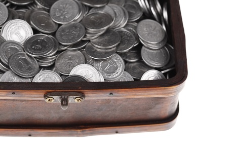 numismatics: Treasure chest full of polish zloty coins isolated on white background  Business and money concept