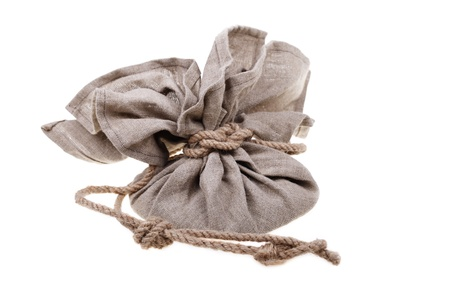 Big linen bag full of money tied by rope  Money and savings concept on white background