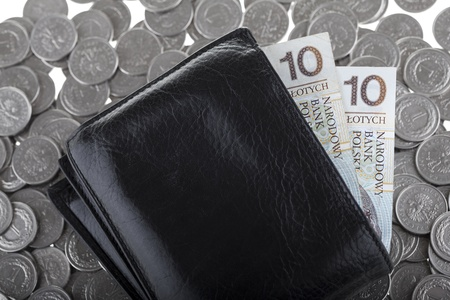 Black wallet with ten polish zloty paper money laying on one polish zloty coins  Money and savings concept