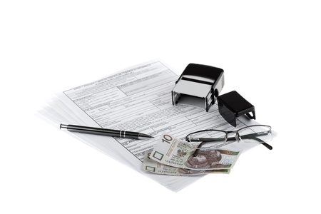 Business documents, polish paper money, pen, stamp and eyeglasses  Money and savings concept  photo