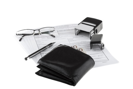 Business documents, wallet with polish paper money, pen, stamp and eyeglasses  Money and savings concept on white background  photo