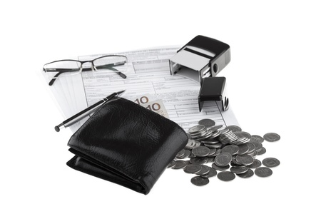 Business documents, wallet with polish paper money, one zloty coins, pen, stamp and eyeglasses  Money and savings concept on white background  photo