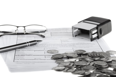 Business documents, polish coins, pen, stamp and eyeglasses  Money and savings concept on white background  photo