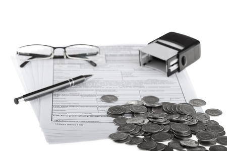 Business documents, polish coins, pen, stamp and eyeglasses  Money and savings concept on white background  Stock Photo