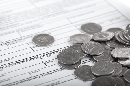 Business documents and one zloty polish coins  Money and savings concept  photo