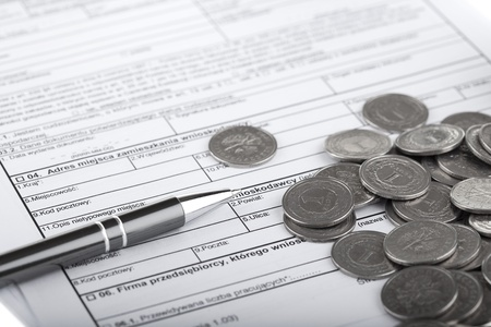 Business documents, one zloty polish coins and pen  Money and savings concept  photo