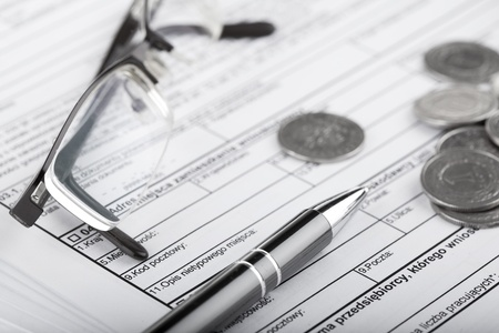 Business documents, eyeglasses, one zloty polish coins and pen  Money and savings concept Stock Photo - 12733979