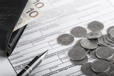Business documents, wallet with polish paper money, one zloty coins and pen  Money and savings concept  photo