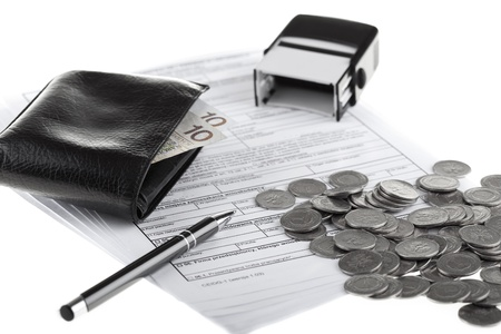 Business documents, wallet with polish paper money, one zloty coins, pen and rubber stamp  Money and savings concept on white background  photo