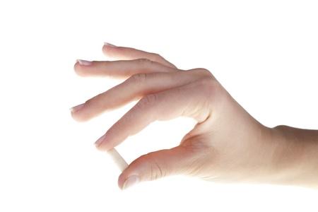 Human hand holding white tablet  Overdose problem