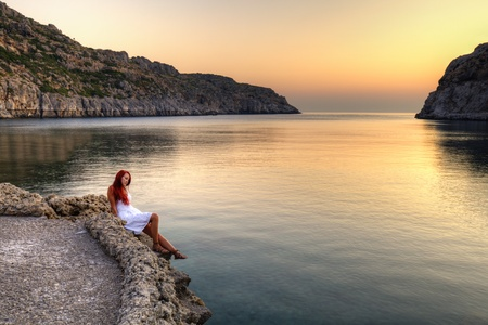 Beautiful young woman watching sunrise on Anthony Quinn Bay  HDR photography of greek landscape - Rhodes Stock Photo - 12733893