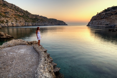Beautiful young woman watching sunrise on Anthony Quinn Bay  HDR photography of greek landscape - Rhodes  Stock Photo - 12733872