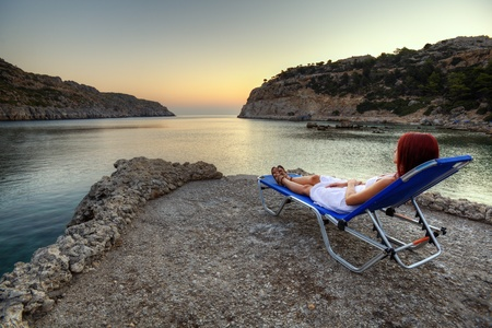 Beautiful young woman watching sunrise on Anthony Quinn Bay  HDR photography of greek landscape - Rhodes  Stock Photo - 12733842