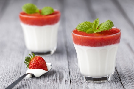 Sweet strawberry mousse with organic yoghurt served in panna cotta way  Fresh fruit dessert decorated with melissa leaf  Stock Photo